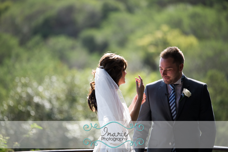 Groom admiring his bride in a private moment