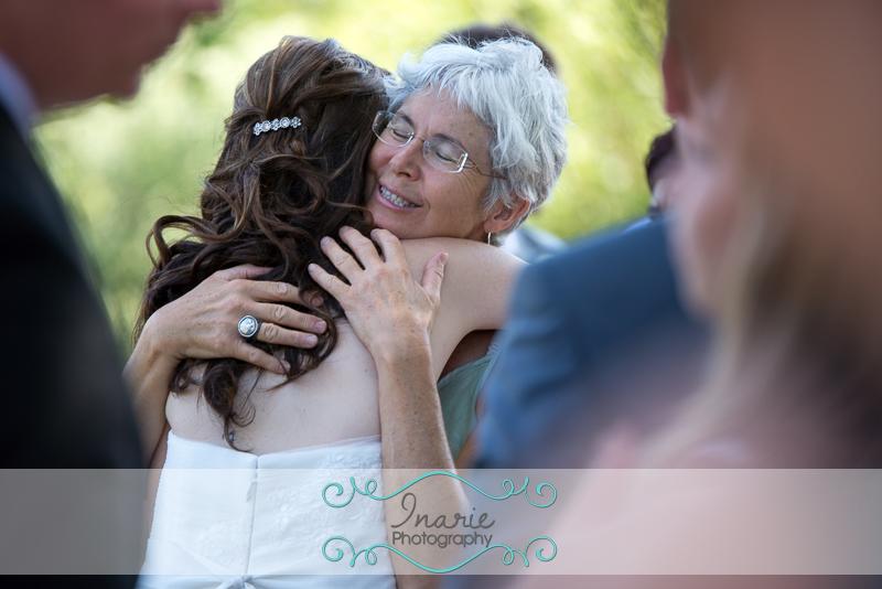 Congratulatory hug to the bride