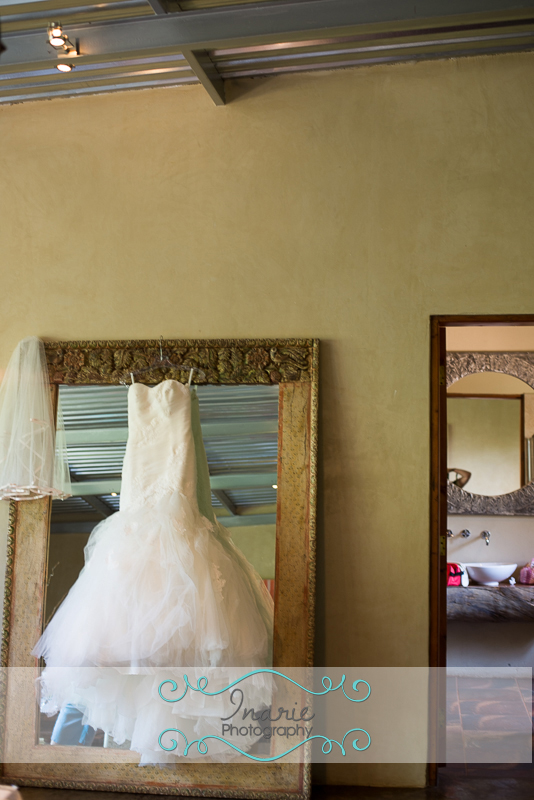 Bride's dress hanging on mirror