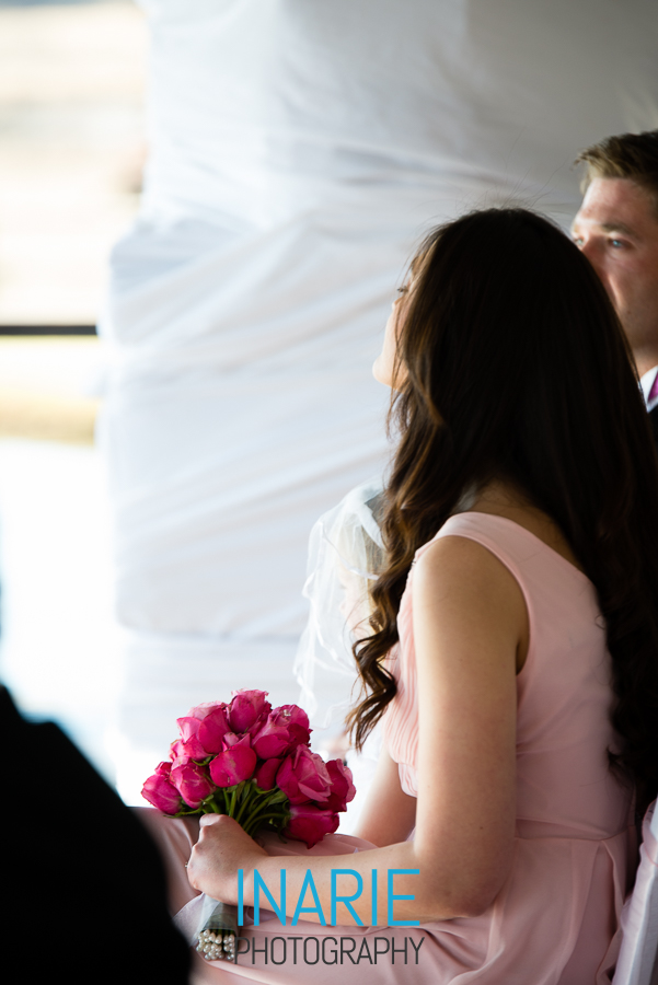 Bridesmaid with pink roses bouquet