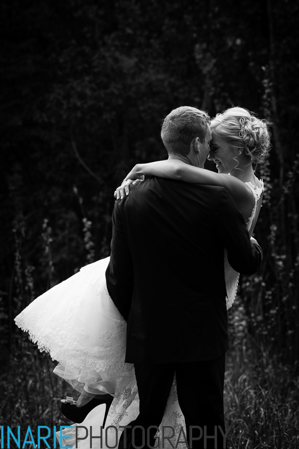 Groom carrying bride - intimate moment