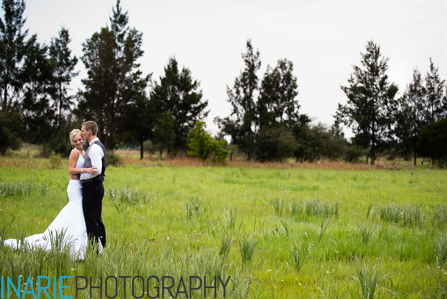 Bride and groom in an open field