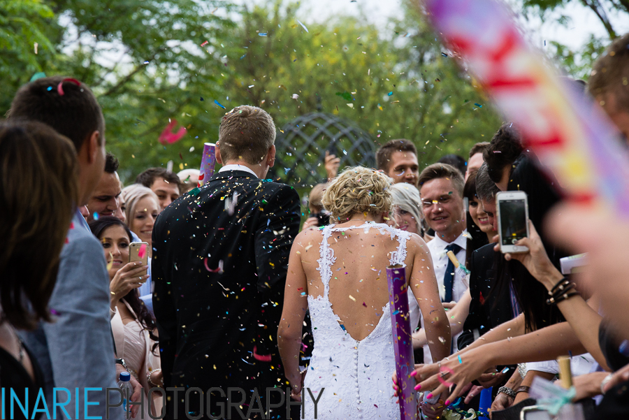 Couple showered with confetti (from the back)