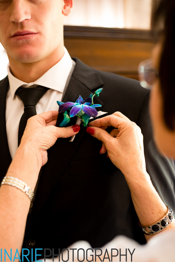 Groom's mother pinning his corsage