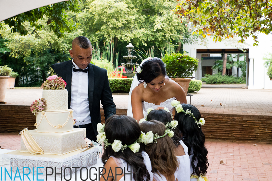 Bride feeding flower girls cake