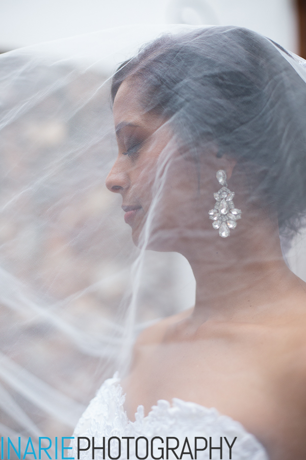 Beautiful bride with her veil over her face