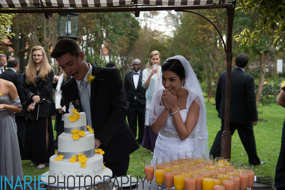 Bride's reaction to groom cutting cake
