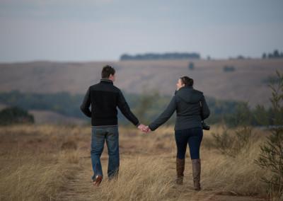 The lovebirds walking in the field