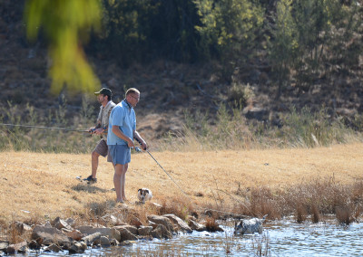 Renier fishing with Lulu and Jocky in the water